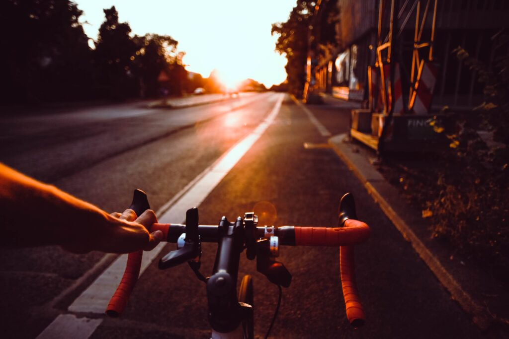 Cycling on an empty road (Source:Unspalsh)